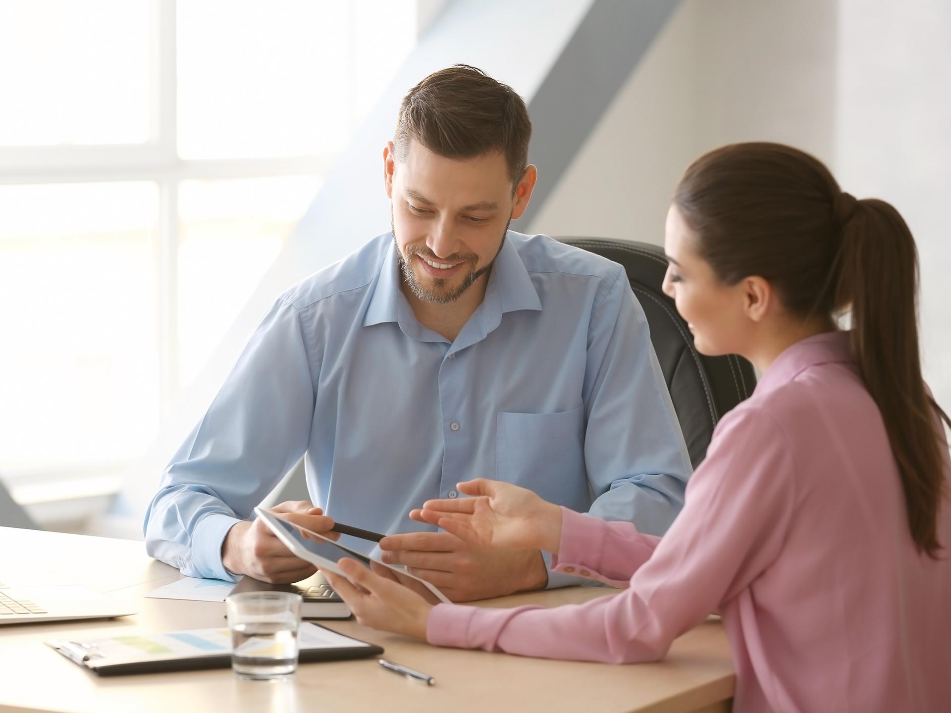 image of sales team members working
